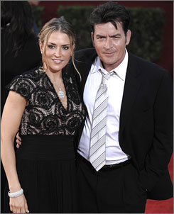 Charlie Sheen and his wife, Brooke Mueller, at the Emmys in September. Her attorney says she was admittted to a hospital in Los Angeles with a temperature of 105 degrees.