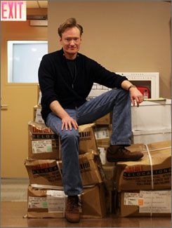 Time to pack up (again): Conan O'Brien, seen here during last year's move from New York to Los Angeles, has struck an exit deal with NBC worth nearly $45 million. He'll receive around $33M with the remainder going to staff severance.