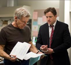 Businessman Brendan Fraser, right, is desperate to get help from Harrison Ford's doctor to save his two kids from a rare disease.