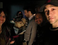 """Self-portrait: Joseph Gordon-Levitt, right, snaps a picture of his small production team, including Cat Solen, left, Tarin Anderson, Jared Geller, Michael Everett and Jose Almeyda. They set up shop in a """"RECroom"""" at Sundance."""
