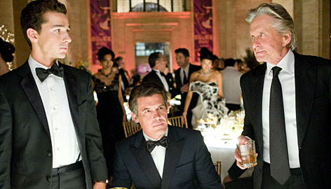 Gordon Gekko (Michael Douglas) has been a free man for seven years in Wall Street: Money Never Sleeps, where he teams up with Jacob Moore (Shia LaBeouf, left) and Bretton James (Josh Brolin).