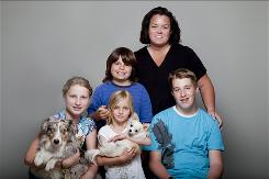 Rosie O'Donnell, who is gay and a single mom, with her children, Chelsea, left, Blake, Vivienne and Parker.
