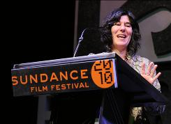 Director Debra Granik accepts grand jury prize for dramatic film for Winter's Bone, the story of a teenage girl in the clannish Ozarks who must find her meth-dealing father.