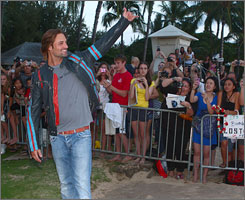 Beaming: Josh Holloway greets the fans at ABC's Lost  Season 6 premiere on Honolulu's Waikiki Beach on Saturday.