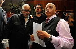 Quincy Jones, singer Lionel Richie and producer Rickey Minor oversee the recording session of We Are The World 25 Years for Haiti.