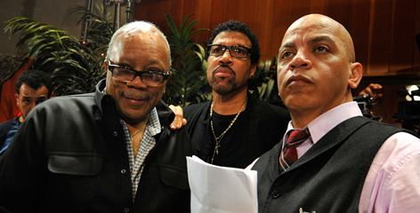 Producer Quincy Jones, left, singer Lionel Richie and producer Rickey Minor get everything ready for the We Are The World recording session at Jim Henson Studios on Monday.