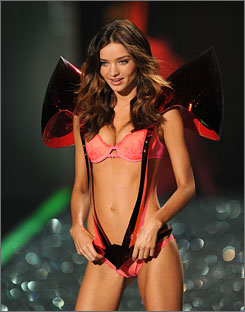 Miranda Kerr, shown here at the annual Victoria's Secret Fashion show in November, says she would have signed a petition to prevent banker Dave Kiely from losing his job if it had come to that.