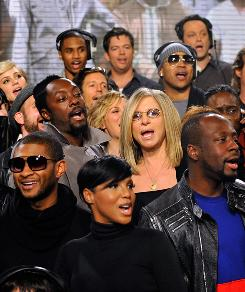 Usher, left, Will.i.am, Toni Braxton, Barbra Streisand and Wyclef Jean join the We Are the World chorus, for Haiti relief efforts..