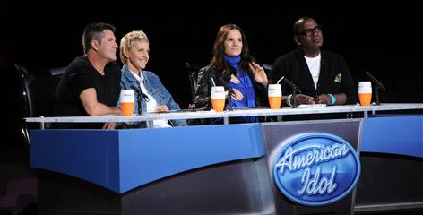 In Paula's old seat: Ellen DeGeneres joins Simon Cowell, left, Kara DioGuardi and Randy Jackson at the judges' table.