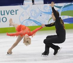 Figure skaters Caydee Denny and Jeremy Barrett perform in the pairs short program Sunday night. The pairs finals airs tonight.