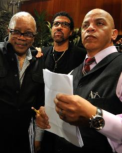 Producer Quincy Jones, left, singer Lionel Richie and producer Rickey Minor gather for the We Are the World: 25 for Haiti recording session at Jim Henson Studios in Hollywood.
