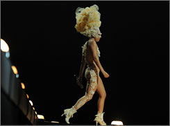 Lady Gaga paid tribute to late designer Alexander McQueen during her first acceptance speech at the Brit Awards.
