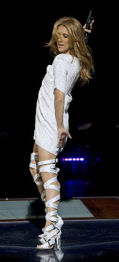 Celine Dion struts her stuff during her Taking Chances tour, which is the basis of the new documentary Celine: Through the Eyes of the World. 