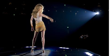 Celine Dion takes the stage by storm, a vision in micro-mini dresses and super-high heels. 