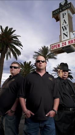 Corey, left, Rick and Richard Harrison of Gold & Silver Pawn Shop host Pawn Stars  on the History Channel. The success of the show has created a boom in the Harrisons' business.