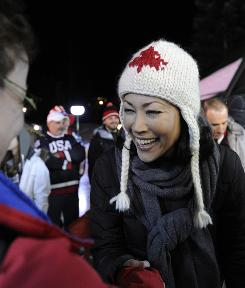 Ann Curry greets a fan at the Grouse Mountain set of the Today show. The host has been enjoying cycling around Vancouver.