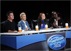 Simon Cowell, left, Ellen DeGeneres, Kara DioGuardi and Randy Jackson are the American Idol  judges.