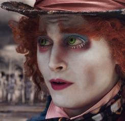 Johnny Depp's flaming-red hair and huge green eyes are the first thing you notice in his portrayal of The Mad Hatter.