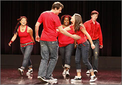 Jenna Ushkowitz, left,  Cory Monteith, Amber Riley, Lea Michele and Chris Colfer in a scene from Glee.