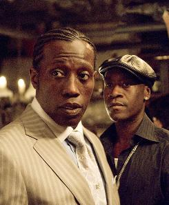 Blurring the line between good and evil: Wesley Snipes, left, and Don Cheadle are part of the ensemble cast.