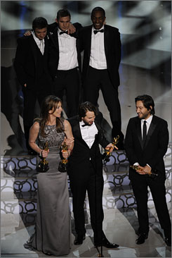 The three stars of The Hurt Locker look on as director Kaythryn Bigelow accepts the best-picture Oscar moments after becoming the first woman to win the directing prize.