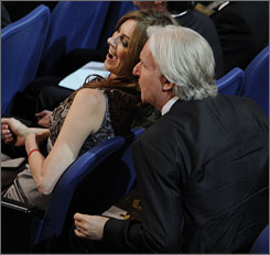 James Cameron cracks a joke to seatmate, best director rival and ex-wife Kathryn Bigelow.