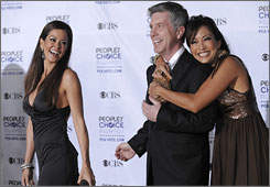 Brooke Burke, left, won her season of Dancing With the Stars. Now she has a new partner  she's joining Tom Bergeron as a co-host.