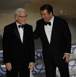 Doing what they do best: Hosts Steve Martin, left, and Alec Baldwin made the rounds of the room with some lighthearted teasing of the stars.