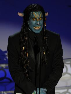 Till he's blue in the face: Ben Stiller presents makeup award as a Na'vi.