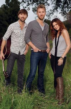 Dave Haywood, left, Charles Kelley and Hillary Scott tour as Lady Antebellum with Tim McGraw.
