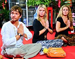 The Price of Beauty: Ken Paves, left, Jessica Simpson and Cacee Cobb learn about the healing powers of meditation from a Buddhist monk in Thailand.
