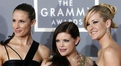 Dixie Chicks, Emily Robison, left, Natalie Maines, and Martie Maguire arrive for the 49th Annual Grammy Awards in Los Angeles.