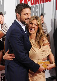Are they or aren't they? Gerard Butler and Jennifer Aniston didn't give a definitive answer at the premiere of their new film.