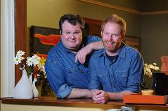 Eric Stonestreet, left, and Jesse Tyler Ferguson play Cameron and Mitchell, a longtime gay couple, on ABC's hit comedy Modern Family.