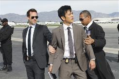 Joseph Fiennes, left, and John Cho star in the ABC sci-fi series FlashForward, in which the entire world blacks out at the same time and sees the future.
