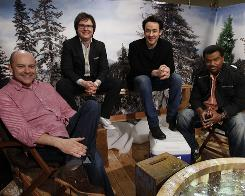 Come on in, the camaraderie's great: Rob Corddry, left, Clark Duke, John Cusack and Craig Robinson are the very damp, very convivial stars of the time-travel comedy Hot Tub Time Machine, opening Friday.