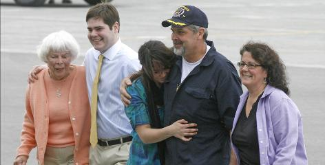 Home safe and sound: Richard Phillips is reunited with his family  mother Virginia, left, son Daniel, daughter Mariah and wife Andrea  after flying into South Burlington, Vt., on April 17, 2009.