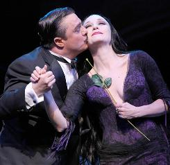 An unusual love: Nathan Lane and Bebe Neuwirth star as Gomez and Morticia Addams in the new musical adaptation of Charles Addams' cartoons.