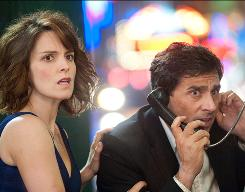 Date night from hell: Claire (Tina Fey) and Phil (Steve Carell) make a frantic call for help.
