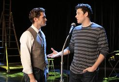 Teacher Will (Matthew Morrison) listens to football player and glee club member Finn (Cory Monteith) in the spring premiere.