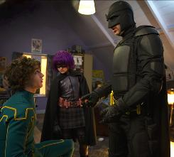 Ordinary people turned superheroes: Not that Kick-Ass (Aaron Johnson, left), Hit-Girl (Chloe Moretz) and her father, Big Daddy (Nicolas Cage), have any special powers to speak of. But they head out to the streets of New York anyway to save the city from gangs and Mobsters.