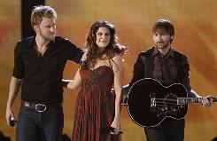 Charles Kelley, left, Hillary Scott and Dave Haywood of Lady Antebellum had a big night at Sunday's Academy of Country Music Awards.