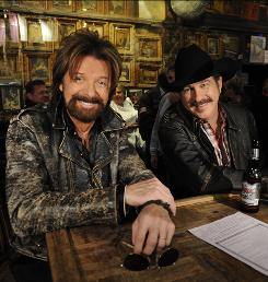 Ronnie Dunn, left, and Kix Brooks plan to part ways after their farewell tour, which ends Aug. 10.
