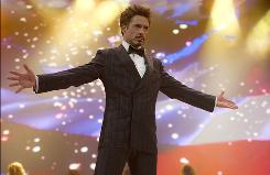 Robert Downey Jr.'s April 26 Iron Man 2 premiere has been moved from London to Los Angeles because of the Icelandic volcano eruption.