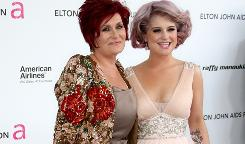 "Sharon Osbourne, shown here with her daughter Kelly,  says the implants will be better on Ozzy's desk ""than on my chest 'cause they're awful."""
