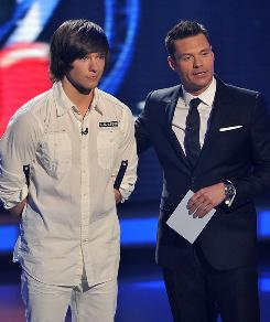 Tim Urban, left, with Ryan Seacreast, was eliminated from American Idol on Wednesday.