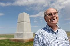 Historian Nathaniel Philbrick, who has written a definitive history called The Last Stand: Custer, Sitting Bull, and the Battle of the Little Bighorn, looks out over the battlefield at the Little Bighorn Battlefield National Monument near Crow Agency, Mont. Behind him is a monument honoring the 7th Cavalry not far from Last Stand Hill.