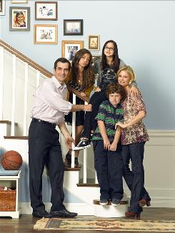 ABC's hit sitcom Modern Family stars Ty Burrell as Phil, Sarah Hyland as Haley, Ariel Winter as Alex, Nolan Gould as Luke and Julie Bowen as Claire.