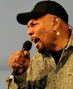 Sing it, brother: Aaron Neville of the Neville Brothers performs Saturday.