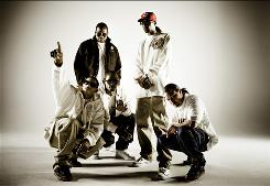 Bone Thugs-N-Harmony are Layzie Bone, front left, Flesh-N-Bone, Bizzy Bone, Wish Bone, standing left, and Krayzie Bone.